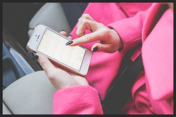 Woman_Checking_iPhone_Calendar-805276-edited.jpg