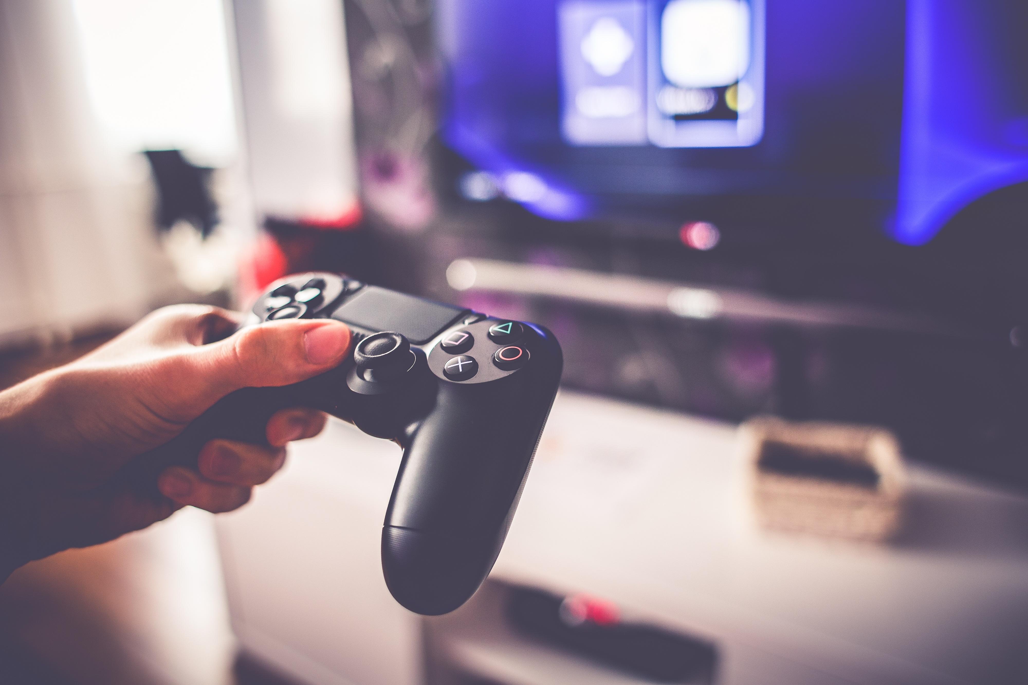 playing-games-on-playstation-4-picjumbo-com.jpg
